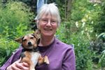 Jayne Nelson and Bertie the dog in her garden